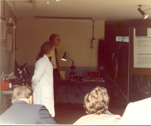 1977 Wallace Deas assisted by technician, Anne Williamson, explains the laboratory techniques used in fertility testing of farm animals